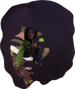 Adrian in garden through Afro frame