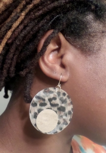 Wearing earrings.